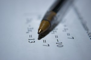 Stift auf Zettel